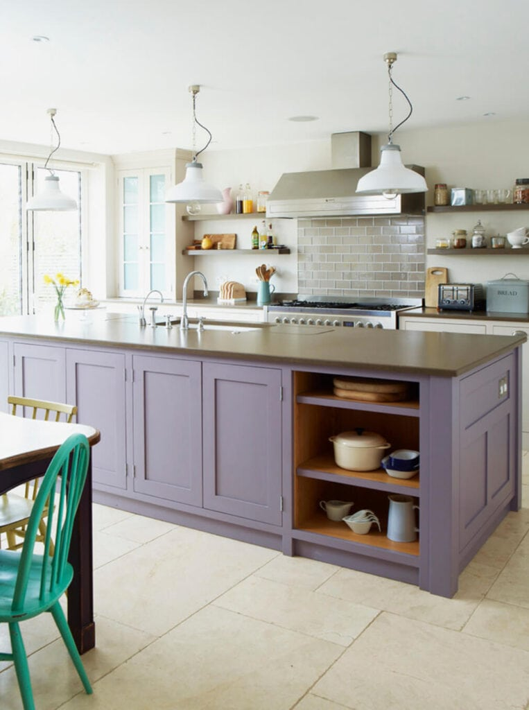 Lilac kitchen island feels cozy and inviting in an off-white kitchen.