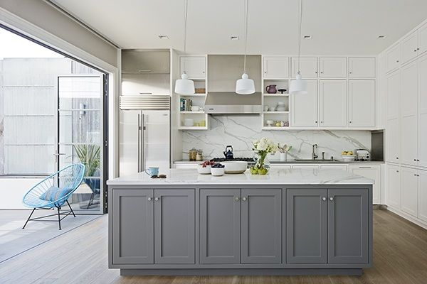 Kitchen with gray island painted in Benjamin Moore's Street Chic, contrasting with white wall cabinets.