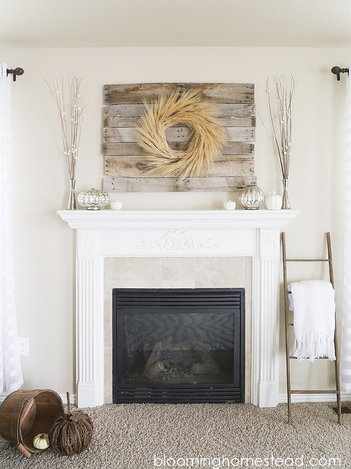 A rustic fall mental with a DIY wheat wreath in the middle
