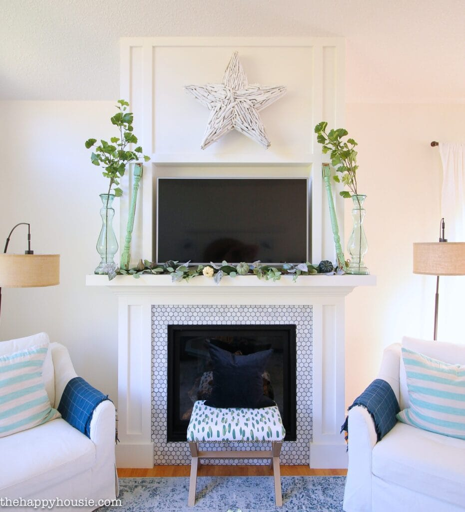 A blue and white mantel with a star in the middle