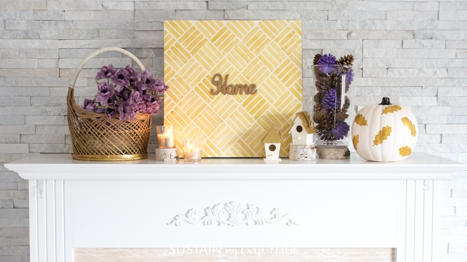 DIY projects on a mantel decorated for fall