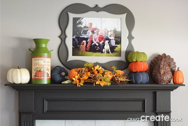 A fall mantel with a family photo as the centerpiece