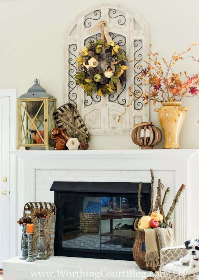 A white fireplace decorated for fall from Worthing Court Blog