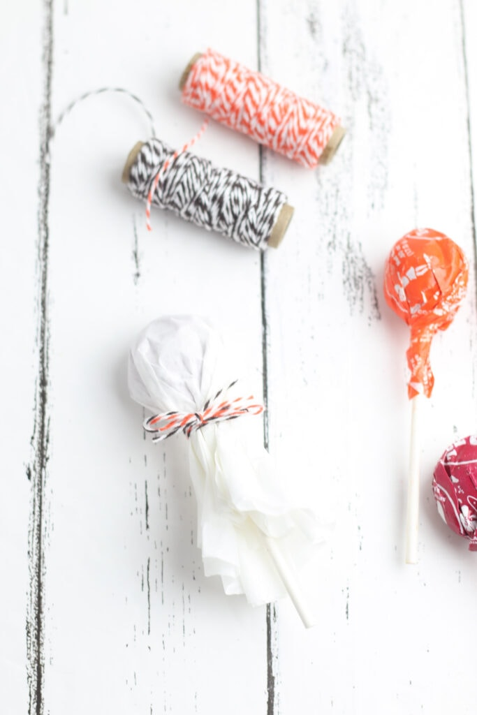 Secure the coffee filter with twine to make a ghost lollipop.