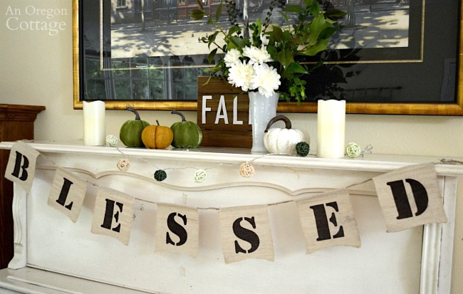The top of a piano decorated for fall with a banner that reads Blessed.