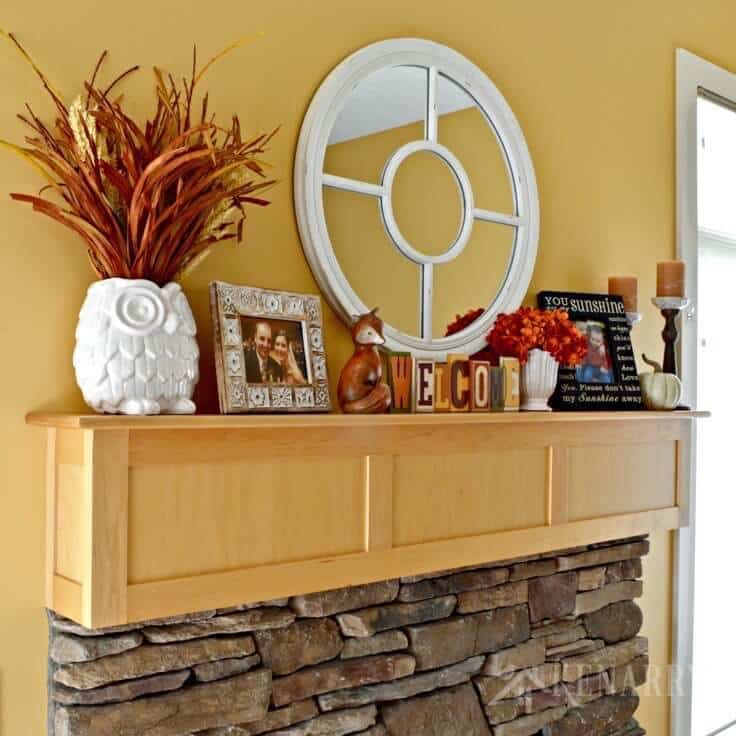 A fall mantel from Ideas For the Home by Kenarry with orange and yellow accents