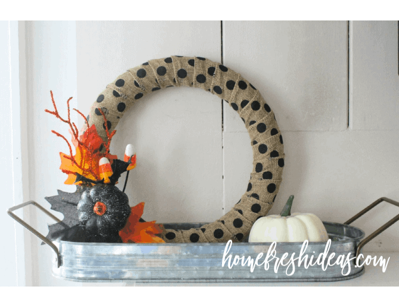 A wreath with polka dots and a painted pumpkin