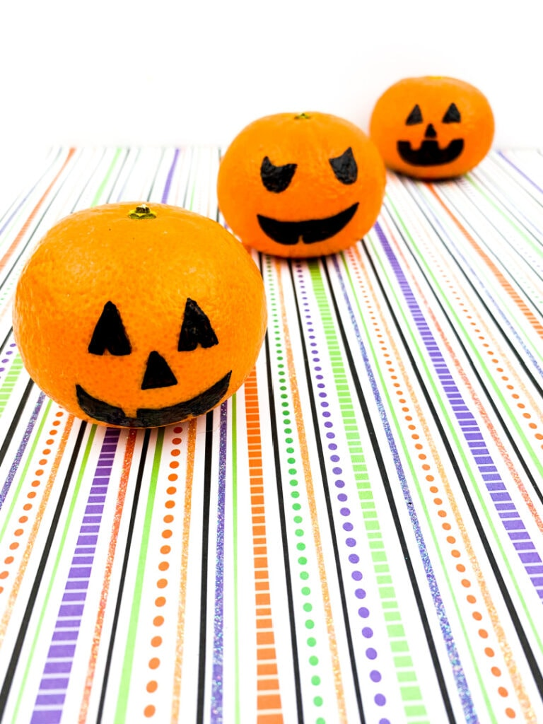 Orange Jack O' Lanterns make cheap DIY Halloween decor.