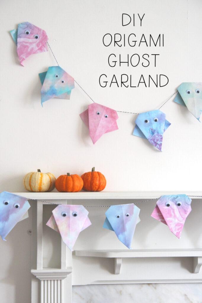 Pastel origami ghost garland: pretty DIY Halloween decor.