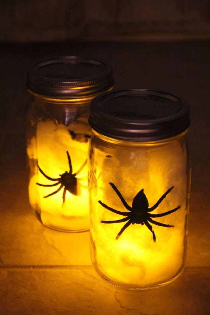 Easy DIY Halloween decorations: Spider mason jar lanterns with spider web batting.