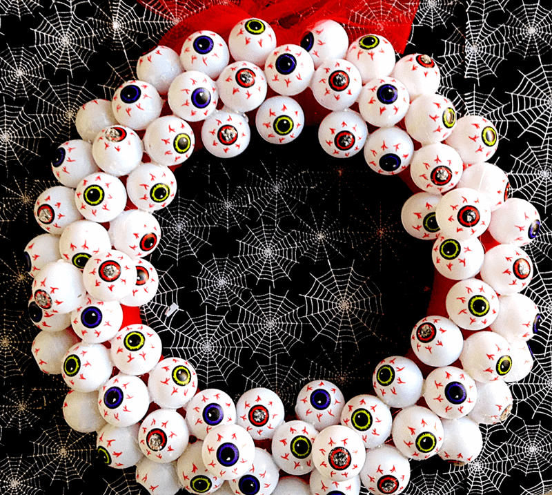 DIY Halloween decor wreath made with eyeballs.