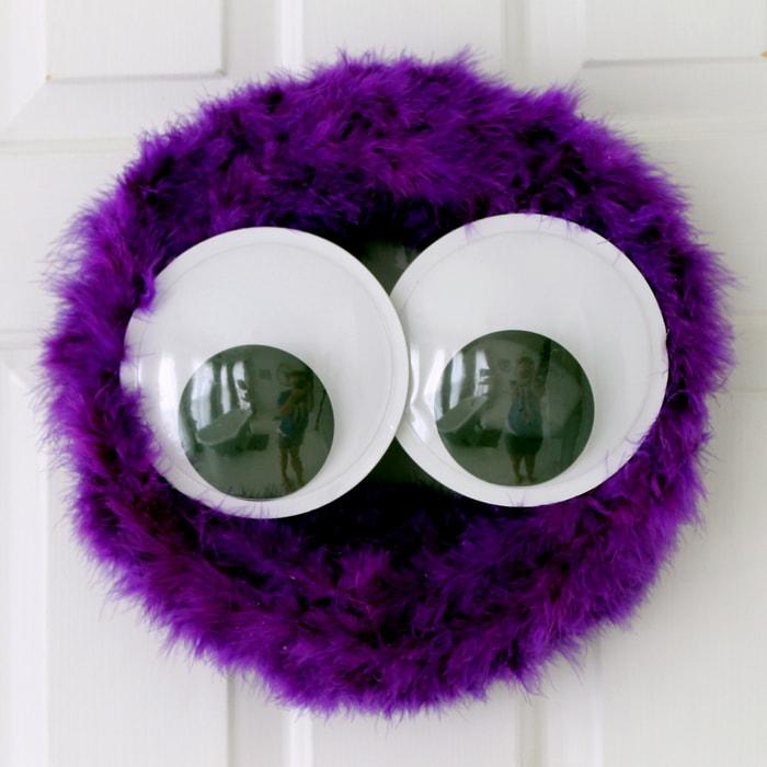 Purple fuzzy monster wreath: DIY Halloween decoration ideas.
