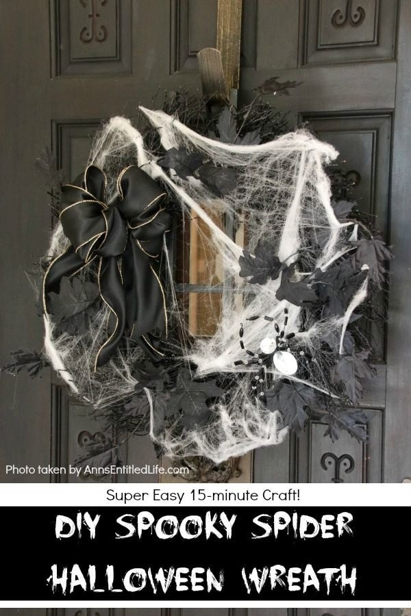Black DIY Halloween decor wreath made with faux leaves, spiders, spiderwebs and a black bow.