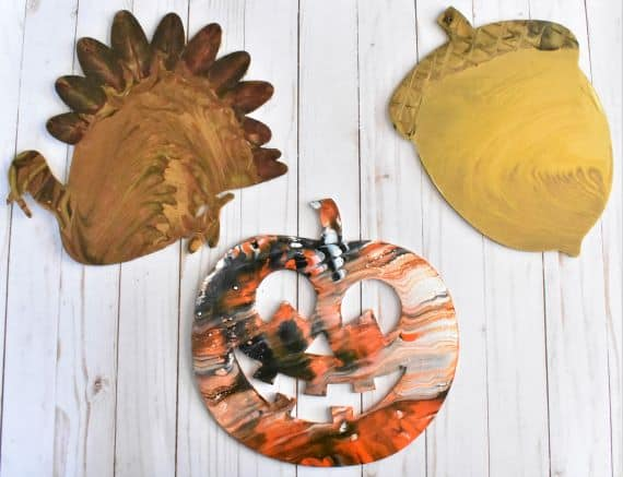 Turkey, acorn and Jack o' Lantern made with acrylic pouring method make great DIY Halloween decorations.