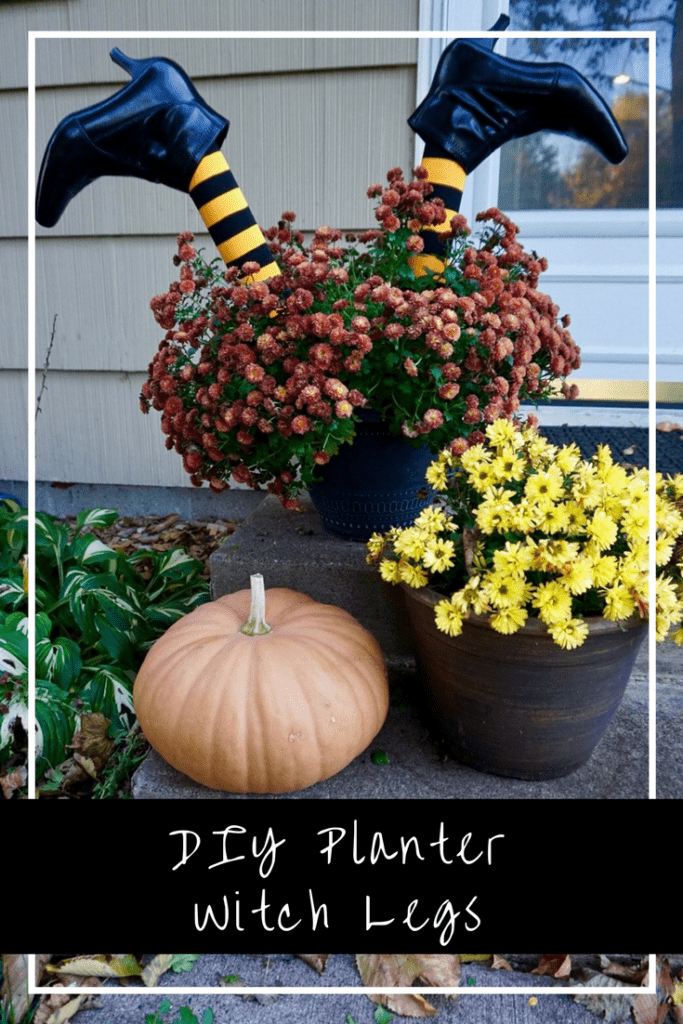Flower planters next to pumpkin. Witch legs sticking out of one of the planters is one of the best DIY Halloween decoration ideas.