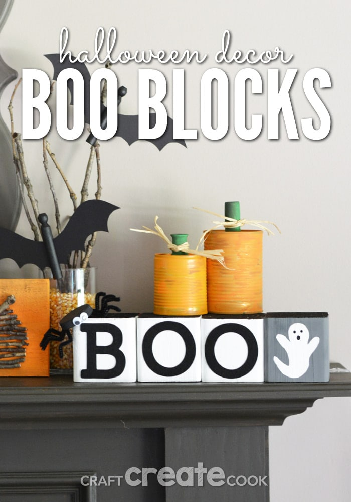 Mantle styled with DIY Halloween decoration ideas, including painted Boo Blocks.