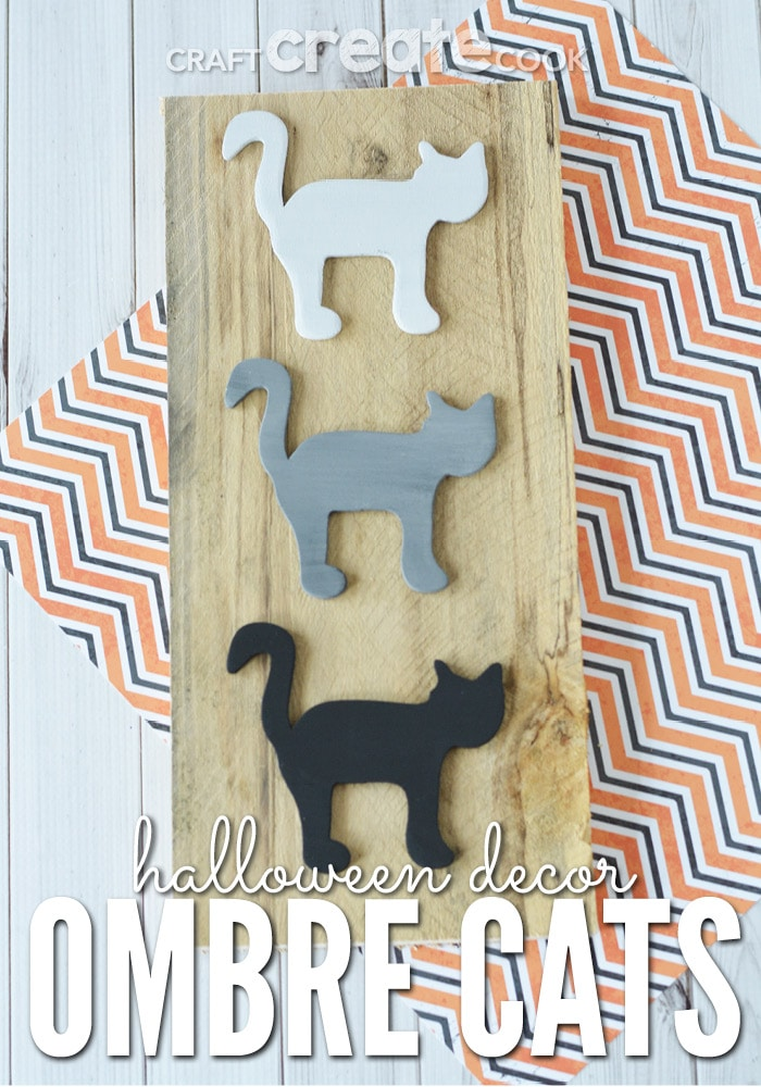 DIY Halloween decor ideas: Ombre Cats painted white, gray and black on a natural wooden board.