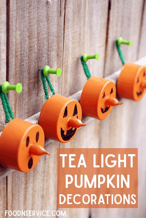 Cheap DIY Halloween decor: flameless tea light candles painted orange to look like pumpkins.