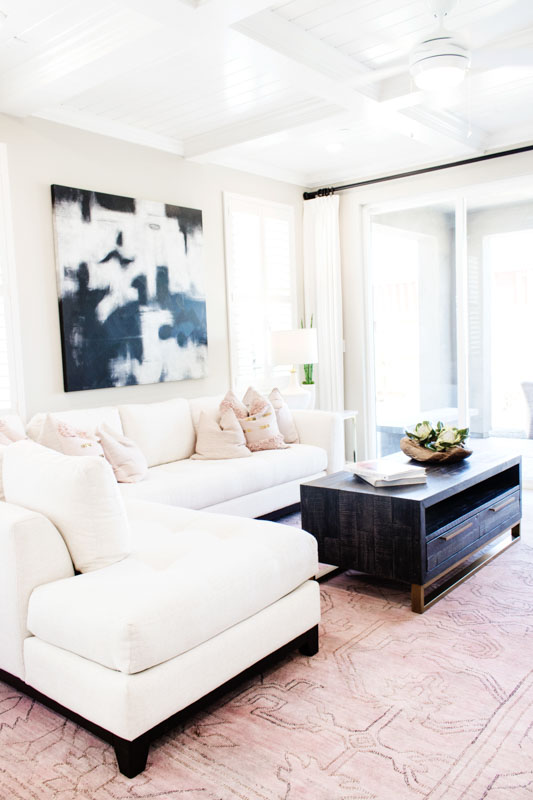 living room filled with target spring decor including greenery, blush rug and pink pillows