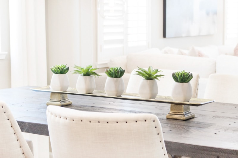 faux green plants on a dining table