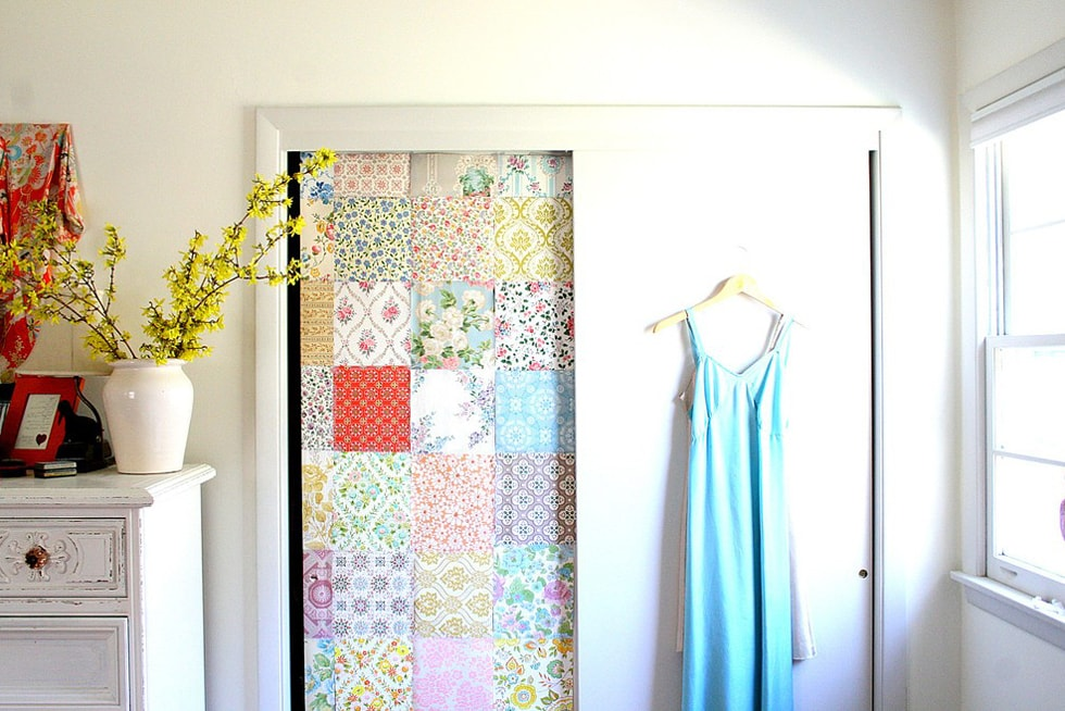 closet doors one of them is covered with multicolored reusable paper