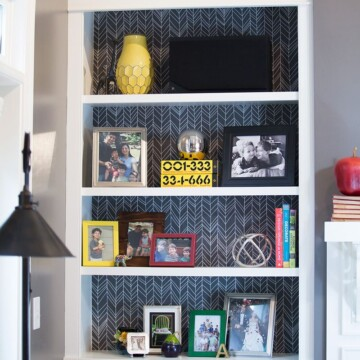 Bookcase that has reusable paper in the back