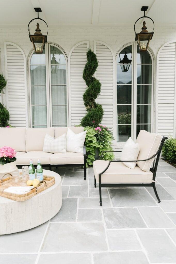 Stone patio flooring  with beige outdoor patio set.
