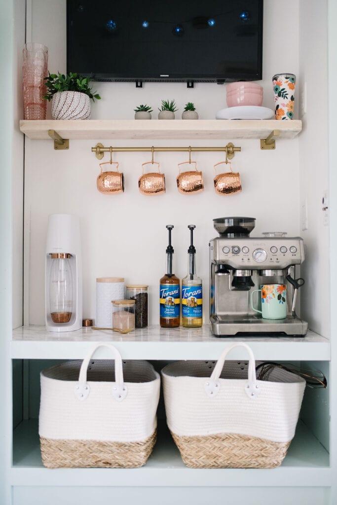coffee bar with coffee machine coffee mugs and flavored syrups