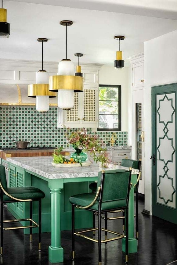 Green and white kitchen with gold accents.