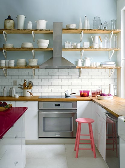 Blue walls in a mostly white kitchen.