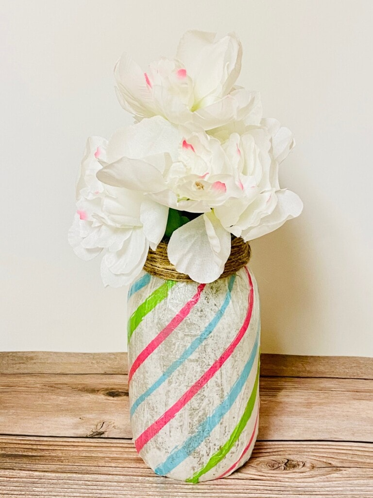 Tissue Paper wrapped round a mason jar as a flower vase