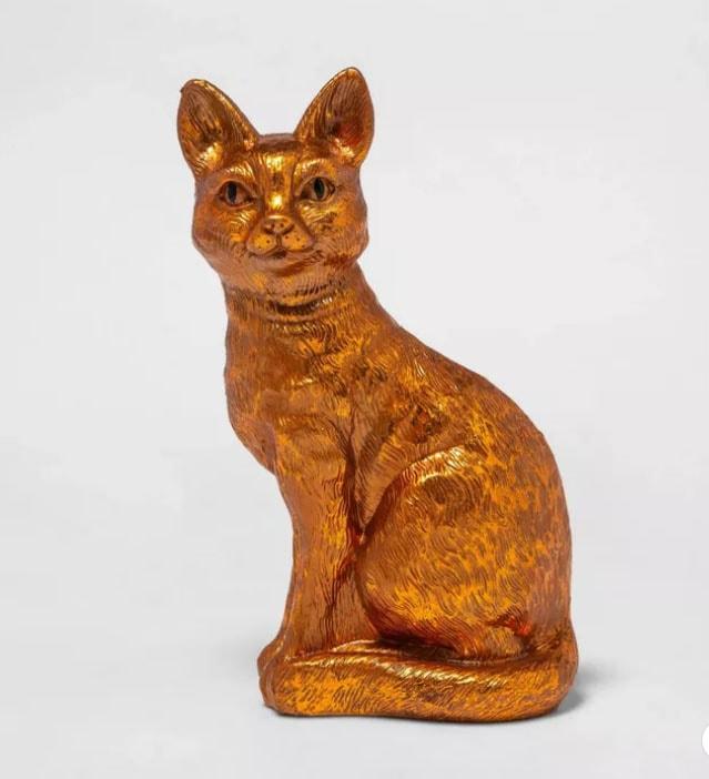 Goldish statue of sitting cat