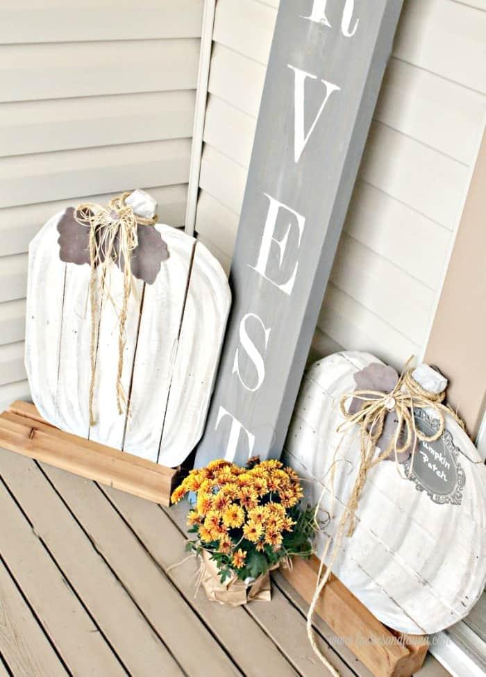 White wood pumpkins porch decor.