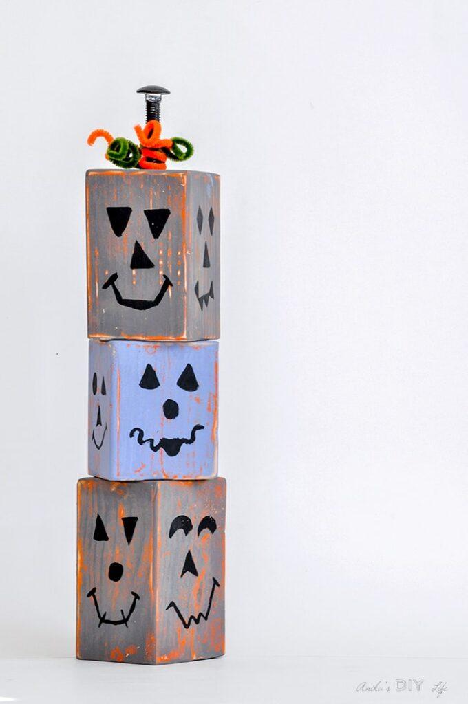 wood blocks painted as pumpkins