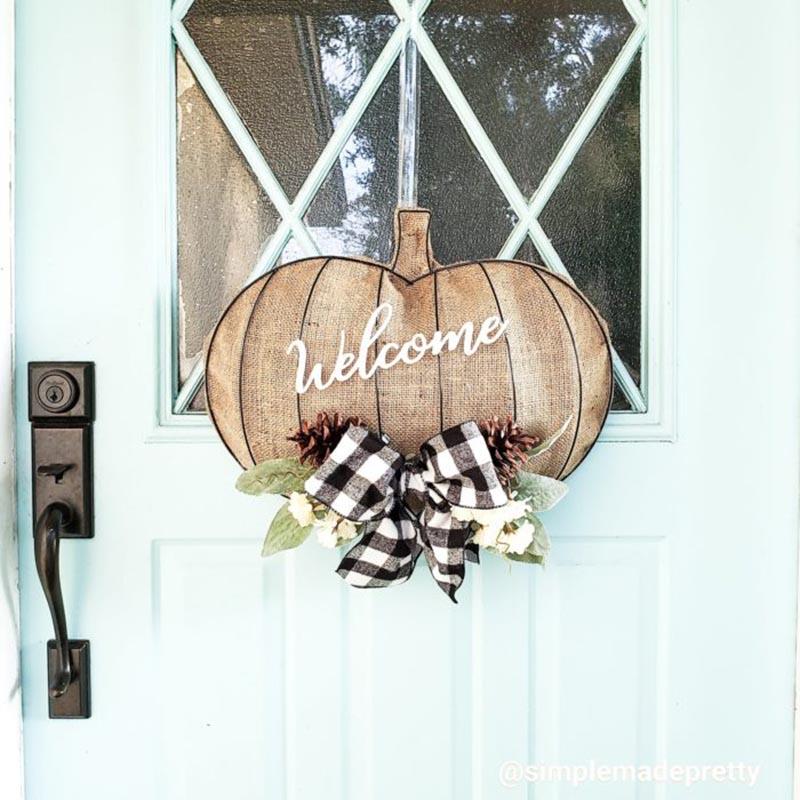 Wood pumpkin door hanger with welcome sign.