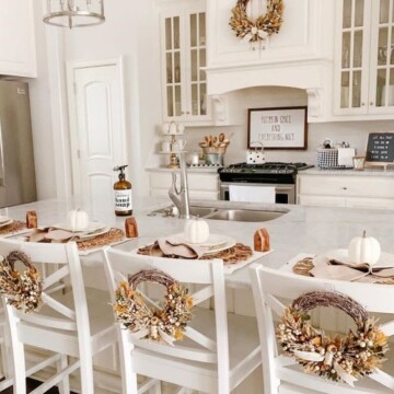 Wreaths on the back of kitchen chairs.