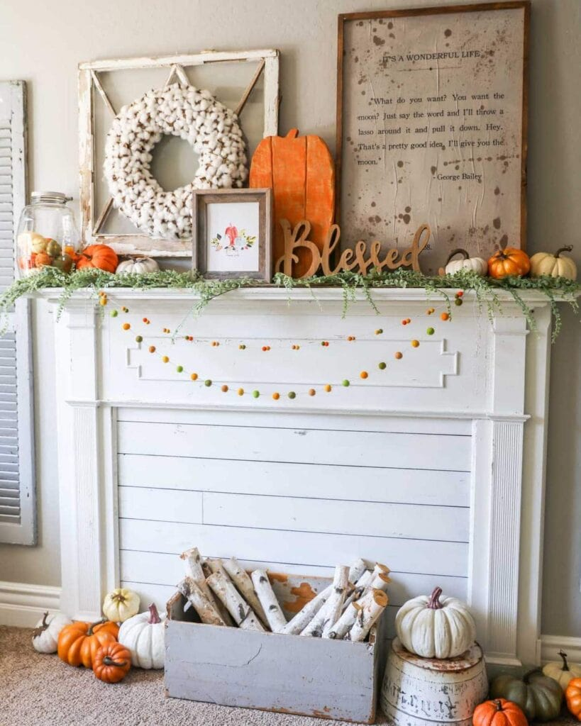 Mantel with fall decor including a orange wood pumpkin.