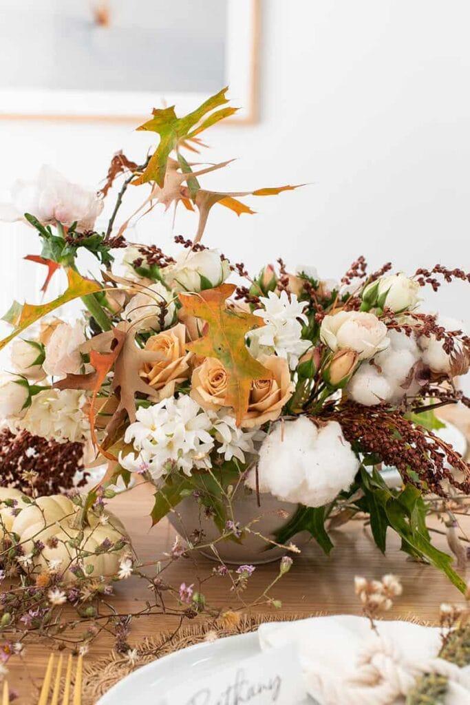 a fresh flower fall centerpiece on a dinner table