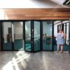 glass wall patio doors with woman and baby